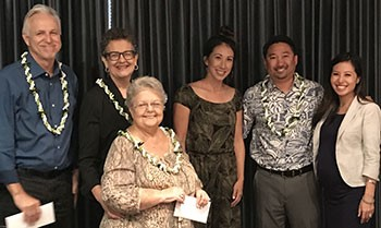 JA President Janel Denny (center) and Board Member Emi Au (far right) congratulate Anthology's partners